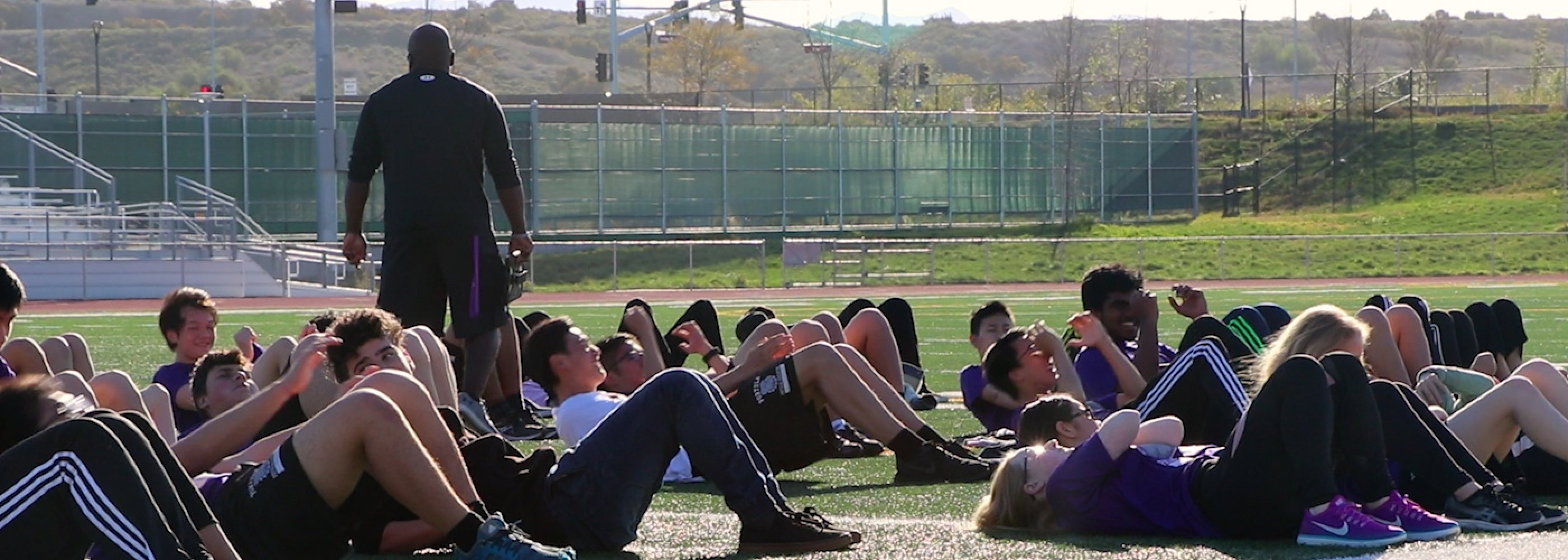 Students doing sit-ups